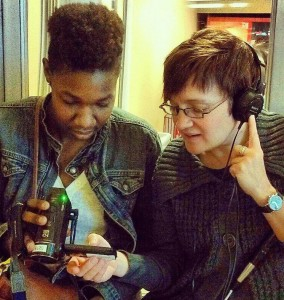 Charitable Words Scholar Elese Daniel and Advisor Elissa Yancey, checking audio levels on a documentary project.